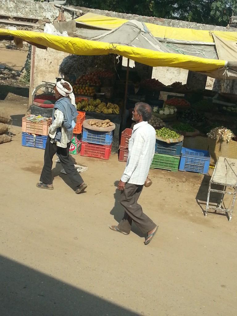 men walking fruit