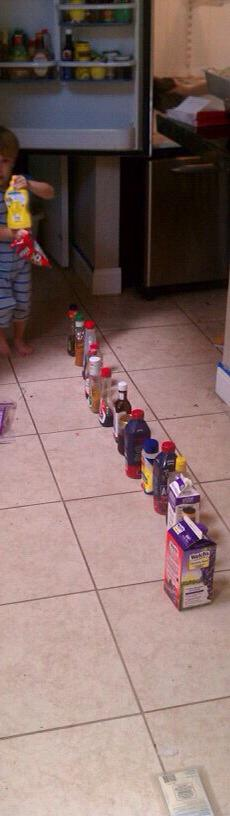 autism stim lining up objects on floor